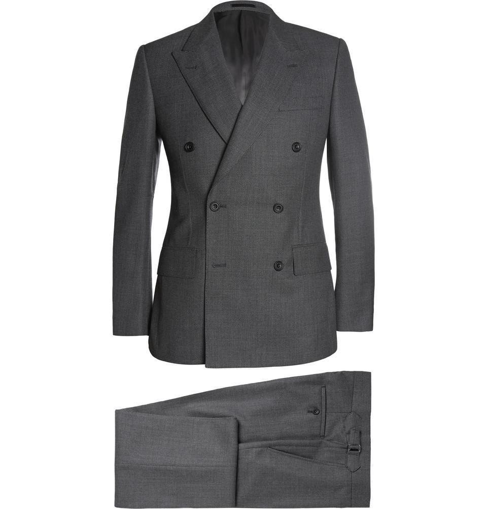 Den mörka kostymen gör sig även utmärkt i dubbelknäppt utförande. Här i en  mörkt grå birdseye från Mr Porters