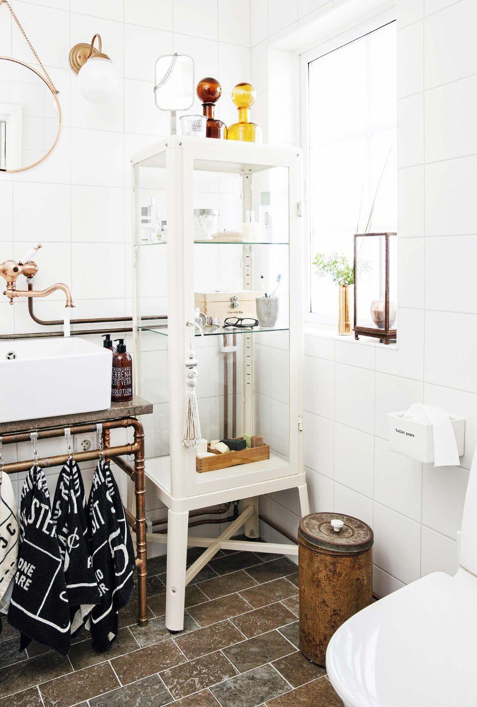SÃ¥ här skapar du ett lyxigt badrum med koppardetaljer – hus & hem